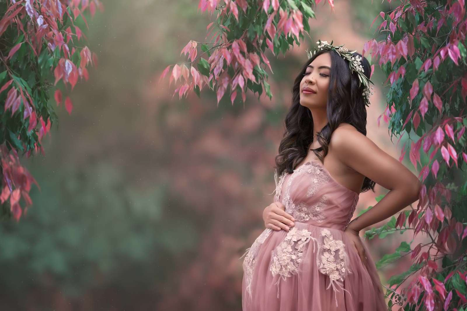 Beautiful lady in pink Katharina Hakaj dress on a Noosa Maternity photoshoot. Wearing blooms of Noosa flower crown.