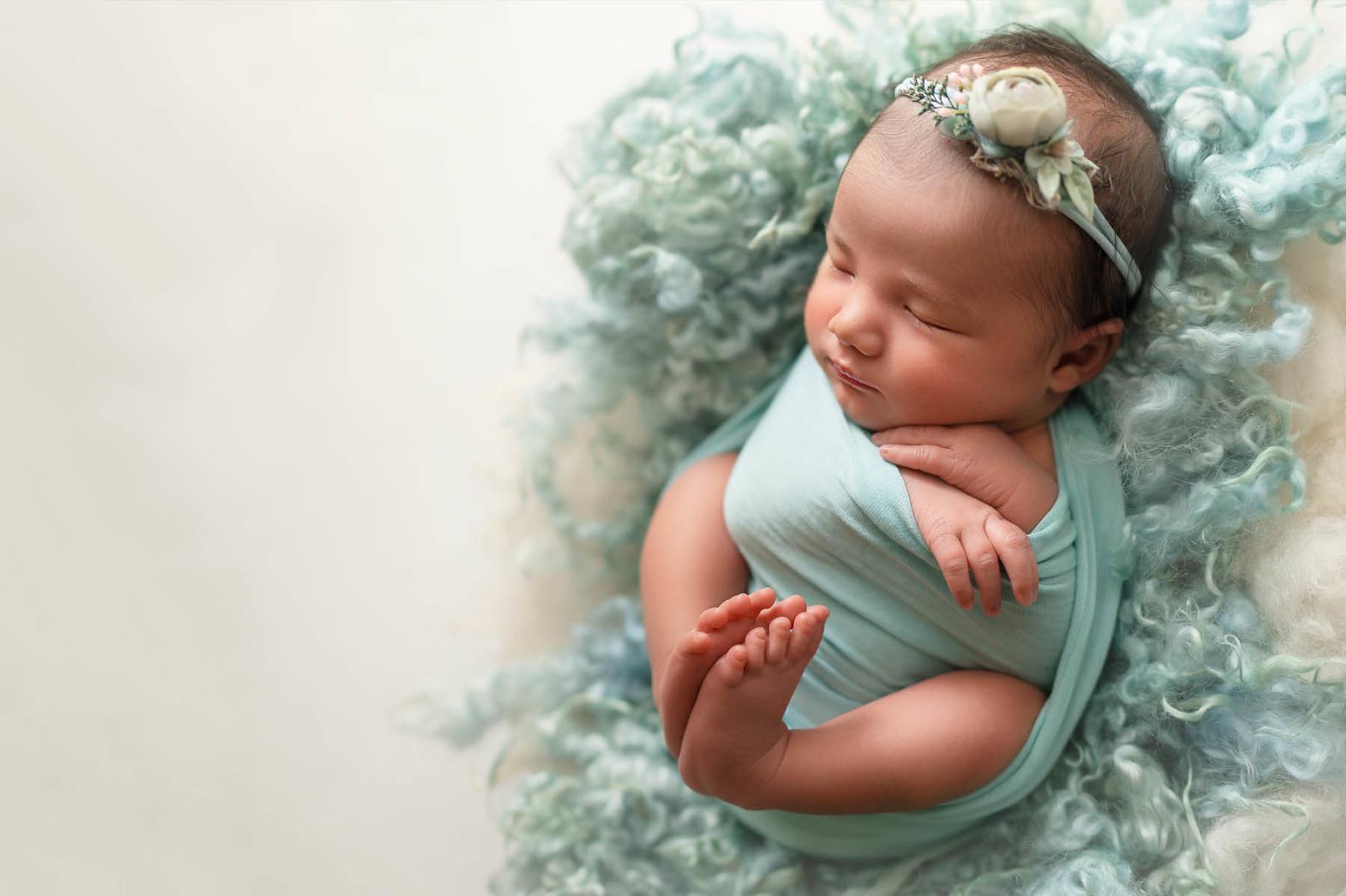 newborn baby in mint