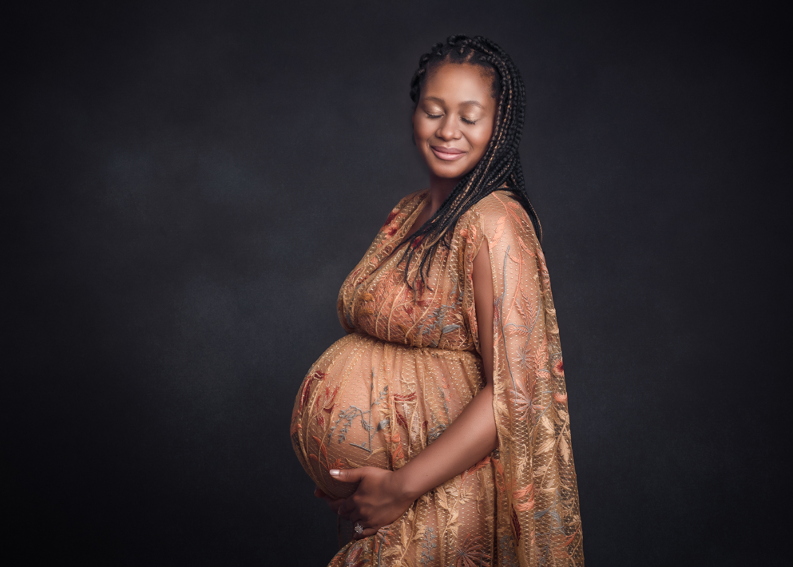 Glowing pregnant lady in golden maternity gown
